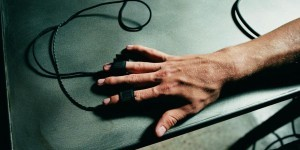 Person's hand hooked up to polygraph test, close-up (Overhead view)